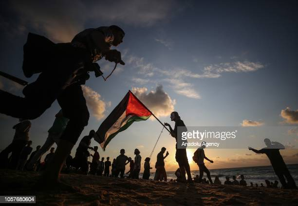 Palestinians throw rock using slingshots during the 15th 'maritime demonstration' to break the Gaza blockade by sea with vessel near the north coast...