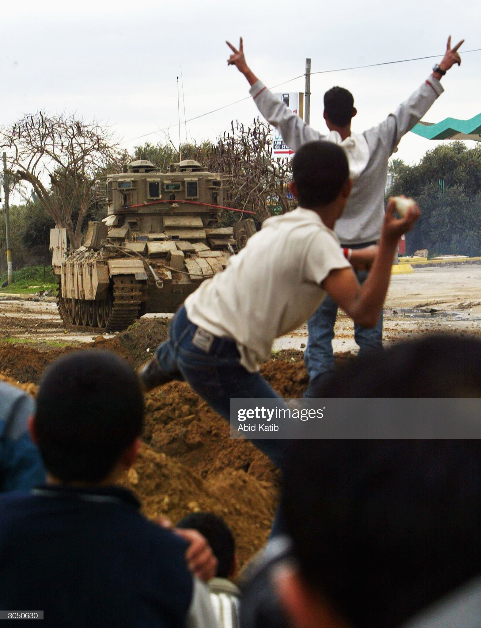 https://media.gettyimages.com/photos/palestinians-throw-stones-towards-israeli-tanks-during-an-israeli-to-picture-id3050630?s=2048x2048