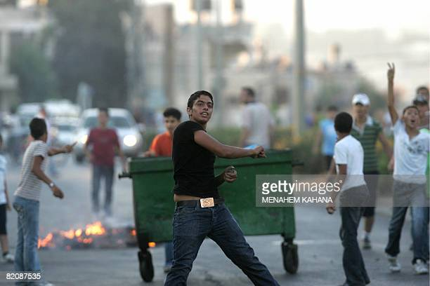 Palestinians throws stones at Israeli police during rioting which erupted in the Palestinian Beit Hanina neighbourhood of East Jerusalem on July 28...