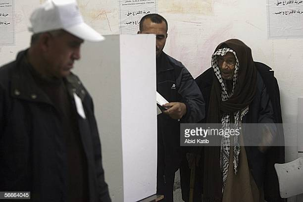 Palestinians vote for Palestinian legislative candidates in the UN school Alef which is being used as an election stationJanuary 25 2006 in Gaza City...