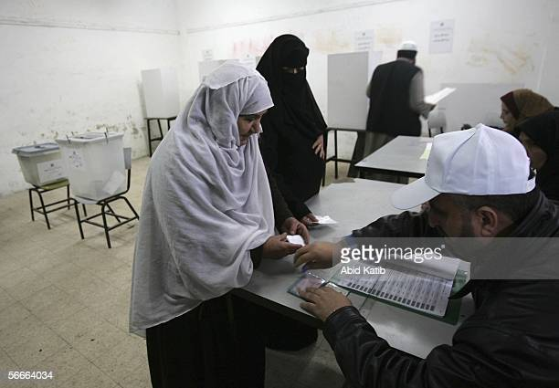 Palestinians vote for the Palestinian legislative candidates in the UN school Alef which is being used as an election station January 25 2006 in Gaza...