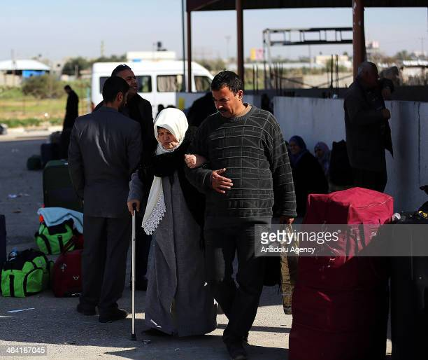 Palestinians wait at the Rafah crossing between Egypt and the southern Gaza Strip on January 21 2014 Egyptian authorities partially opened the Rafah...