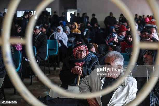 Palestinians wait for passport control at the Rafah Border crossing after the gate temporarily reopened in Rafah Gaza on January 28 2017 Egyptian...