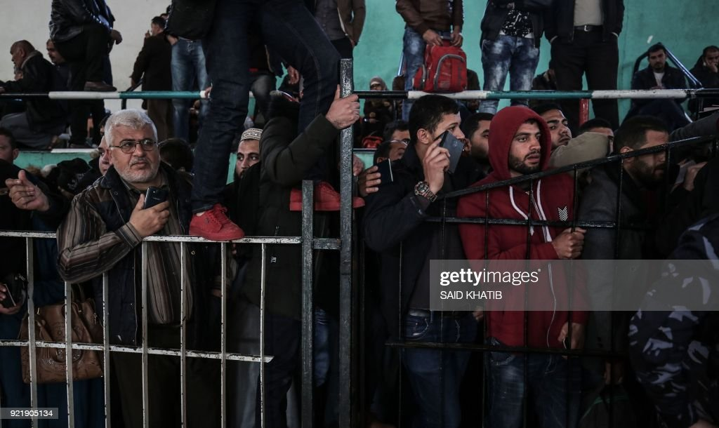 Palestinians wait for permission to cross into Egypt through the Rafah border crossing in the southern Gaza Strip after it was opened by Egyptian authorities on February 21, 2018. Both Israel and Egypt have maintained blockades of Gaza for years, arguing that they are necessary to isolate Hamas. /
