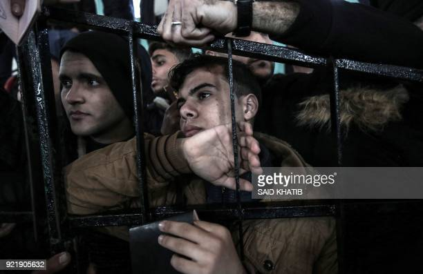 Palestinians wait for permission to cross into Egypt through the Rafah border crossing in the southern Gaza Strip after it was opened by Egyptian...