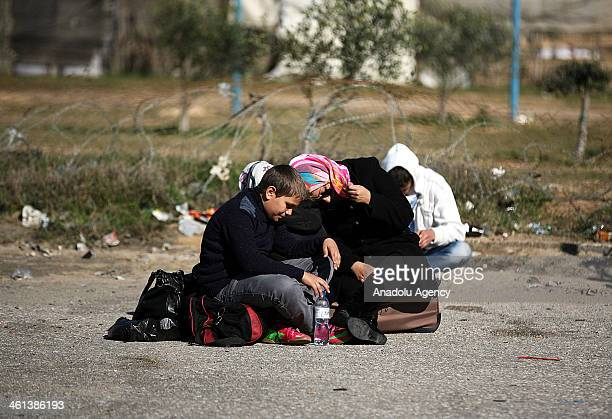 Palestinians wait for the crossing into Egypt at Rahaf border crossing between Egypt and the southern Gaza Strip on January 8 2014 Egypt has opened...