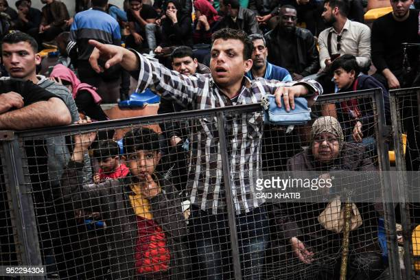 TOPSHOT Palestinians wait for travel permits in Khan Yunis to cross into Egypt from the Rafah border crossing in the southern Gaza Strip on April 28...