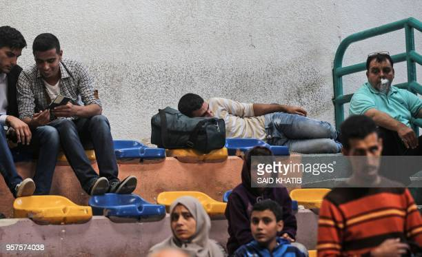 Palestinians wait for travel permits in Khan Yunis to cross into Egypt from the Rafah border crossing in the southern Gaza Strip on May 12, 2018.