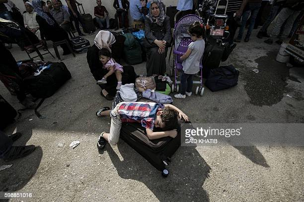Palestinians wait for travel permits to cross into Egypt through the Rafah border crossing, on September 3, 2016 in the southern Gaza Strip. Egyptian...