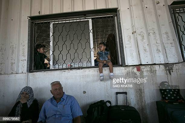 Palestinians wait for travel permits to cross into Egypt through the Rafah border crossing, on September 4, 2016 in the southern Gaza Strip. Egyptian...