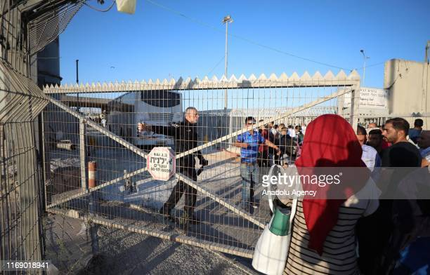 Palestinians wait in a queue after Israeli forces got under control the check point following a Palestinian woman was shot and martyred by Israeli...