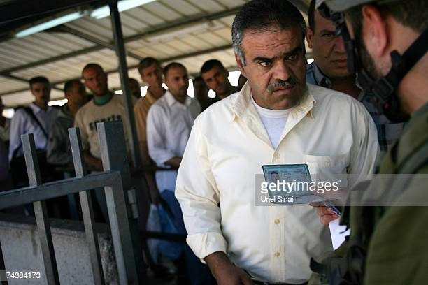 Palestinians wait in line at the Hawarra checkpoint on June 3 near the West Bank city of Nablus West Bank Palestinians will mark forty years of...