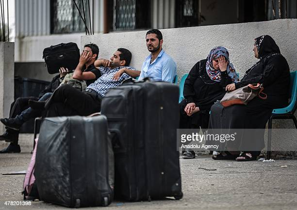 Palestinians wait to cross into Egypt at Rafah border crossing on the border between Egypt's Sinai and the Gaza Strip on June 23 2015 in Rafah town...