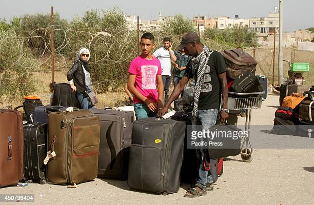 Palestinians wait to cross into Egypt at the Rafah border crossing between Egypt and the southern Gaza Strip. After the Egyptian President Mohamed...