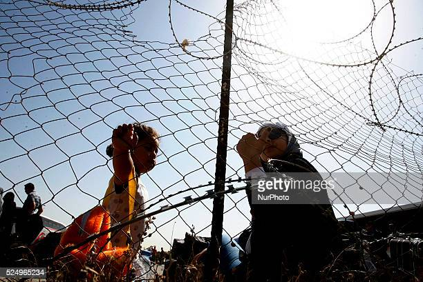 Palestinians wait to cross into Egypt at the Rafah border crossing between Egypt and the southern Gaza Strip on June 17, 2014. Egyptian authorities...
