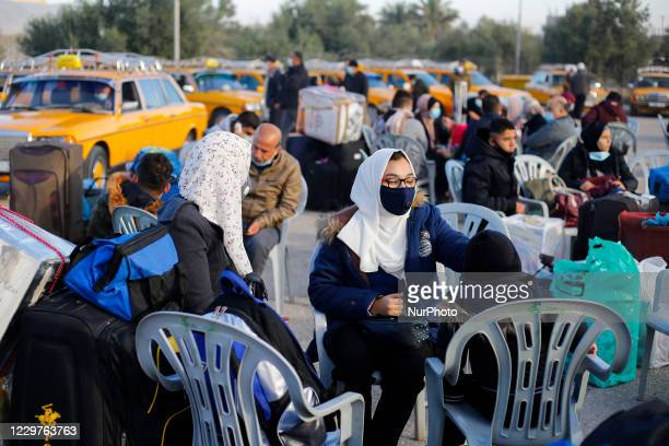 Palestinians wait to cross into Egypt at the Rafah crossing between Egypt and Gaza Strip in the southern Gaza Strip on November 24 2020 Egyptian...
