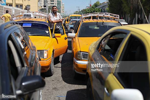 Palestinians wait to fill their cars with benzine at a fuel station in Gaza City on September 8 2013 A fuel shortage in the Gaza Strip started after...