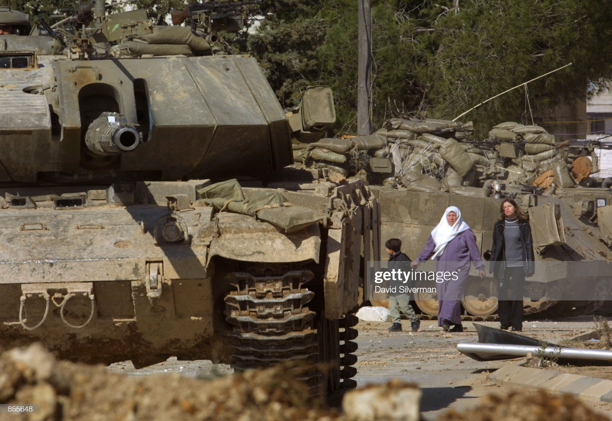 https://media.gettyimages.com/photos/palestinians-walk-between-israeli-tanks-positioned-opposite-leader-picture-id855648?s=2048x2048