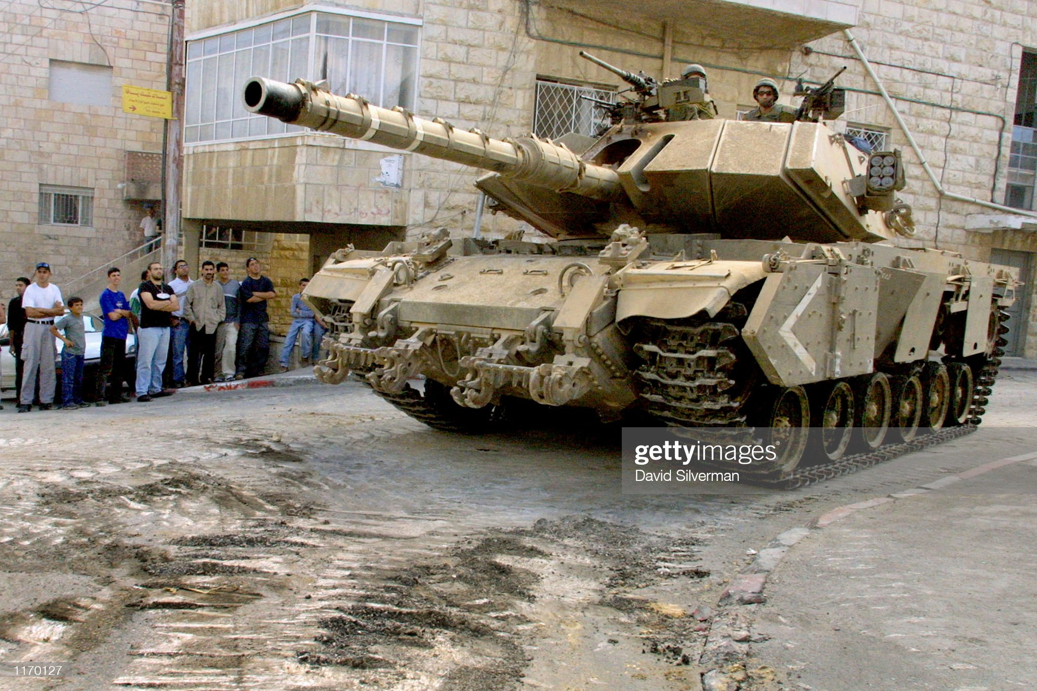 https://media.gettyimages.com/photos/palestinians-watch-as-an-israeli-tank-changes-position-october-26-in-picture-id1170127?s=2048x2048