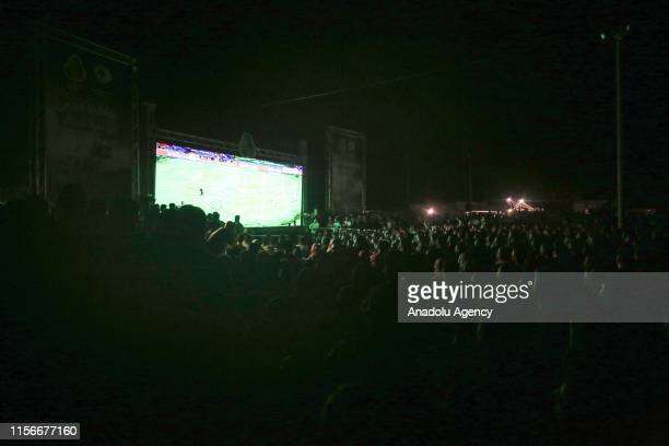 Palestinians watch the 2019 Africa Cup of Nations final between Algeria and Senegal on a giant screen in Gaza City on July 19, 2019. Algeria won 2019...