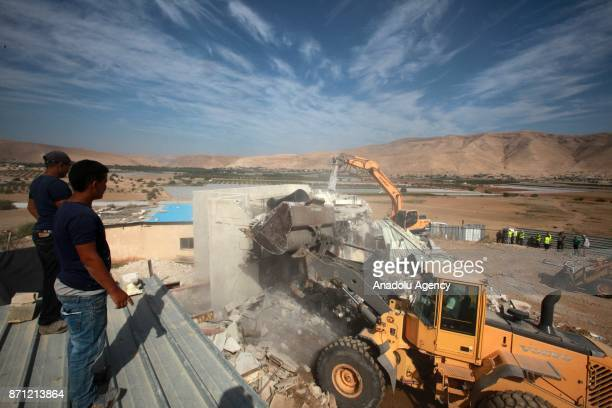 Palestinians watch the demolition of their house at a farm in north of Jordan Valley in Tubas West Bank on November 07 2017 Israeli soldiers...