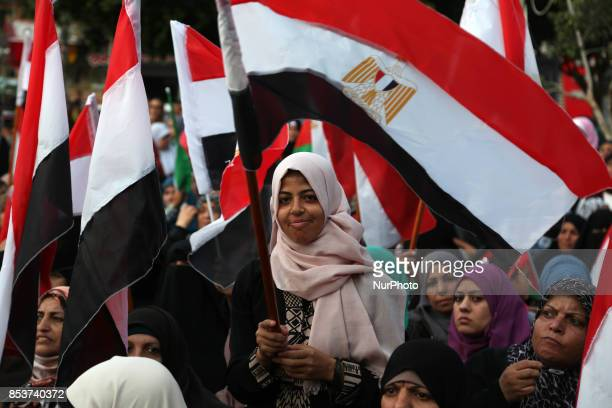Palestinians wave the Egyptian flags during a rally to say ''Thank'' to Egypt for its support for Palestinian reconciliation in Gaza city on...