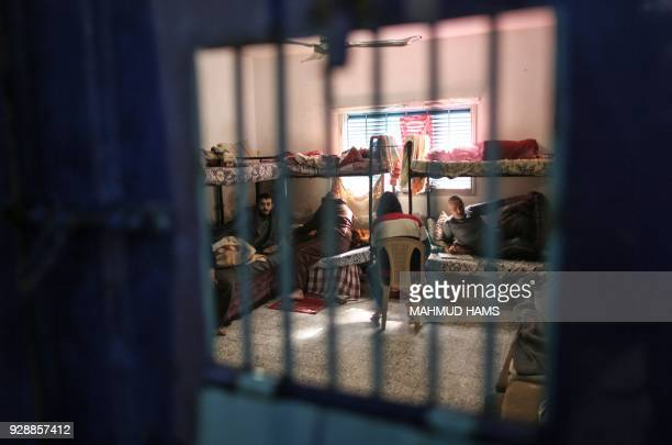 TOPSHOT Palestinians who are unable to pay off their debts sit in a cell in a Hamas jail in Gaza City on February 20 2018 Over 40000 Gazans were...