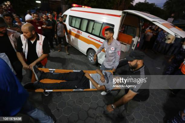 Palestinians who got injured during the 'Great March of Return' demonstration arrive at at Al Aqsa Hospital in Deir Al Balah Gaza on October 12 2018