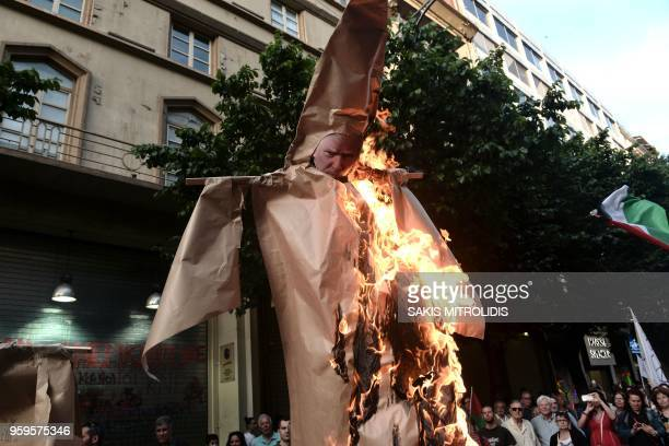 Palestinians who live in Thessaloniki burn an effigy of US President Donald Trump in front of the US consulate during a demonstration on May 17 to...