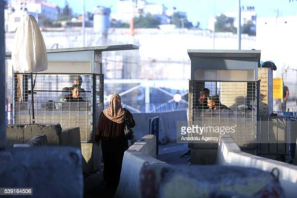 Palestinians who want to visit AlAqsa Mosque on the first Friday of Islamic holy fasting month of Ramadan enter Jerusalem from the Kalandia...