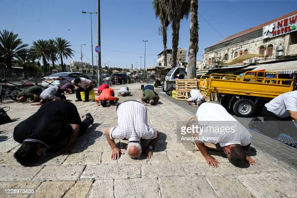Palestinians, who weren't allowed to enter Al-Aqsa Mosque by Israeli forces as people outside of Old City were not let through as part of the...