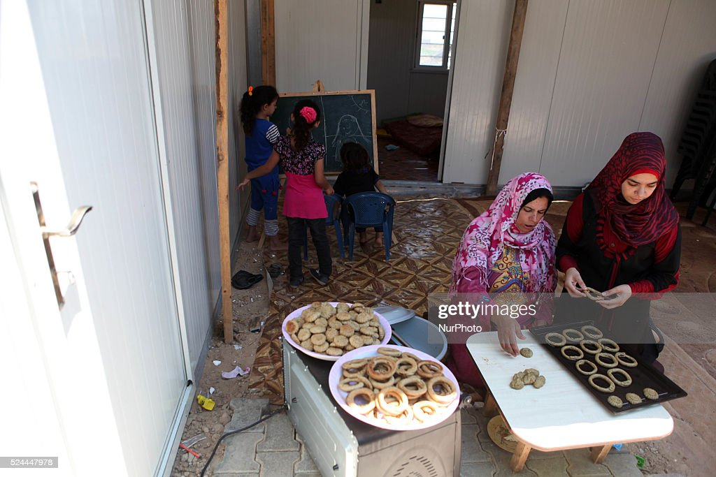 Palestinians, whose house was destroyed by what witnesses said was Israeli shelling during a 50-day war last summer, make traditional cake inside their makeshift shelter, ahead of Eid-al-Fitr celebrations in Beit Lahia in the northern Gaza Strip July 15, 2015.