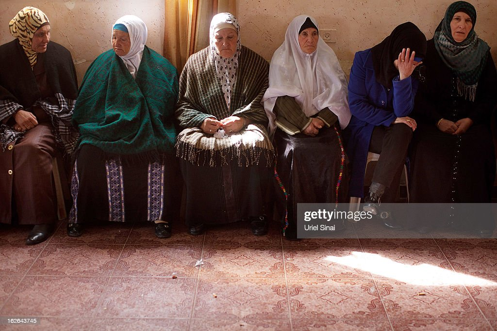 Palestinians women mourn during the funeral Arafat Jaradat on February 25, 2013 in the village of Saair in the West Bank. According to reports, Jaradat died while in Israeli custody under disputed circumstances, with Palestinian officials saying an autopsy showed he was tortured.