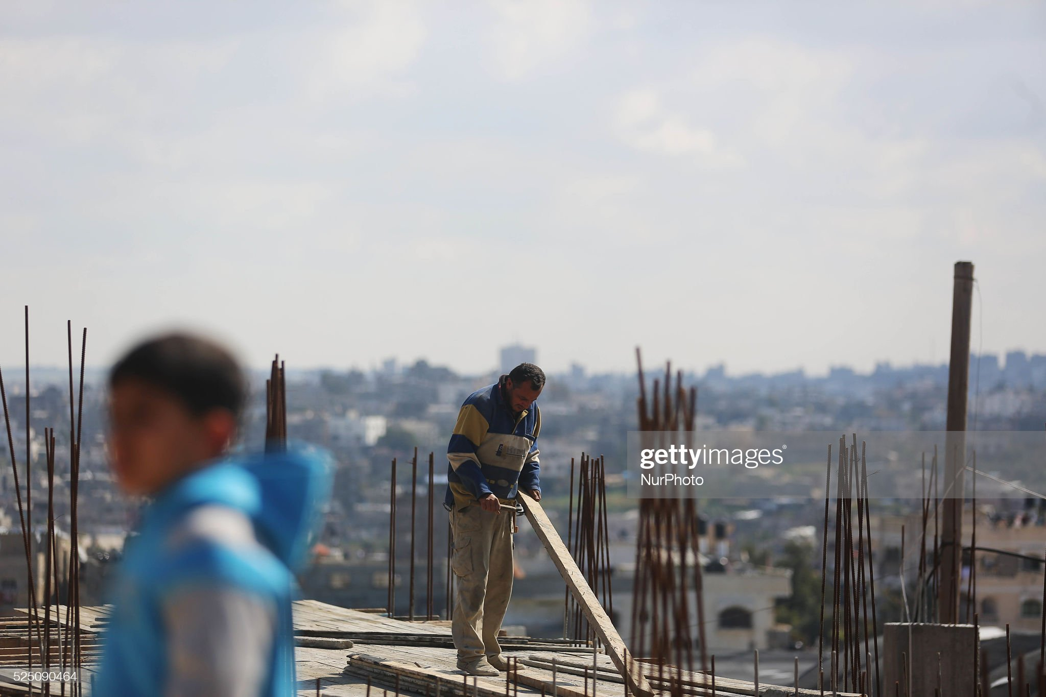 Palestinians work at houses which destroyed during 2014 war, in Beit Lahiya the North Gaza city : News Photo