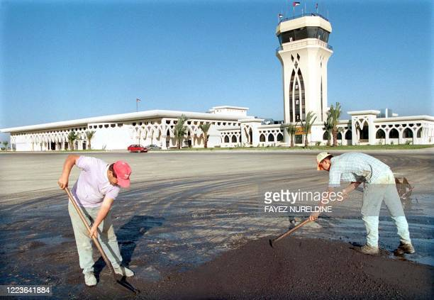 Palestinians workers asphalt a road at Gaza International airport in Rafah on the Gaza Strip 27 October. The Wye River memorandum signed in...