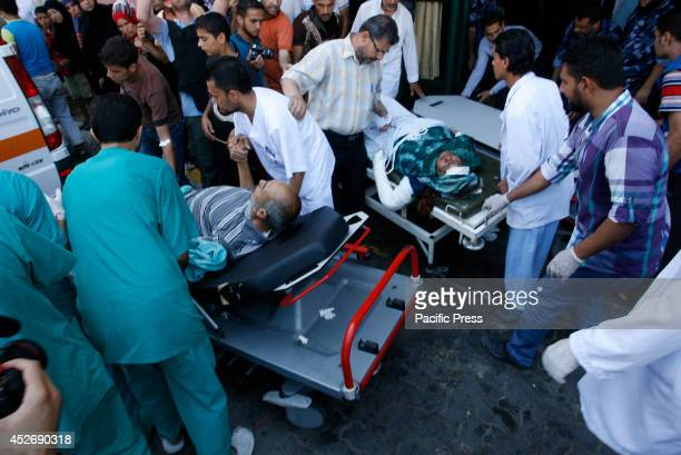 Palestinians wounded following an Israeli air strike, arrives at a hospital in Khan Yunis in the southern Gaza Strip. Israeli tanks and warplanes...