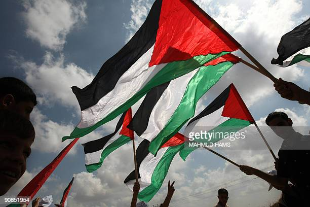Palestinians youth waves their national flag during a demonstration against the Israeli siege and calling for the release of Palestinian prisoners...