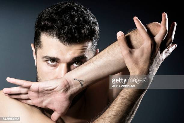 PalestinianSyrian ballet dancer Ahmad Joudeh poses during a photo session on July 18 2017 in Paris Joudeh will perform on July 20 2017 on the Human...