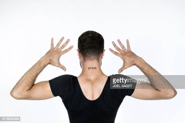 PalestinianSyrian ballet dancer Ahmad Joudeh poses during a photo session on July 18 2017 in Paris Joudeh's neck tattoo reads Dance or Die in sanskrit