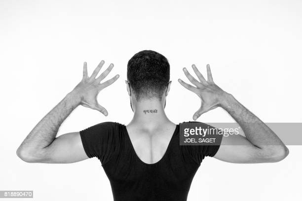 PalestinianSyrian ballet dancer Ahmad Joudeh poses during a photo session on July 18 2017 in Paris Joudeh's neck tattoo reads Dance or Die in...