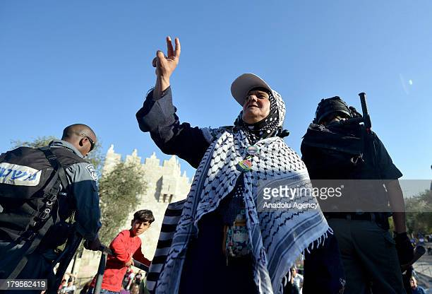 Palestinina woman with peace sign during a demonstration on August 26 2013 in Jerusalem The demonstrators are protesting after Israel security forces...