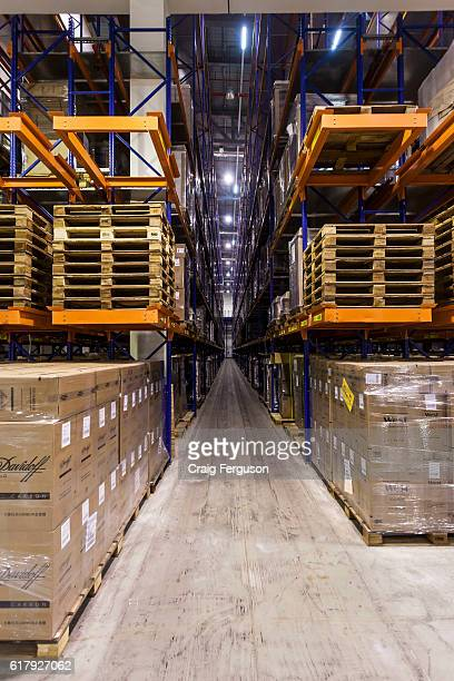Palettes of cigarettes from various brands await distribution at an Imperial Tobacco factory. The company, which rebranded as Imperial Brands in...