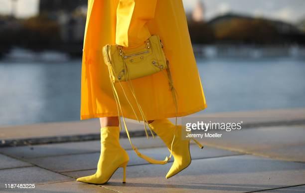 Palina Kozyrava wearing Vetements raincoat, Asos shoes and Balenciaga bag on November 04, 2019 in Cologne, Germany.