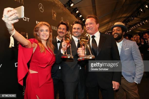 Palina Rojinski Florian David Fitz Simon Verhoeven Arnold Schwarzenegger Erich Kabongo take a selfie during the Bambi Awards 2017 winners board at...