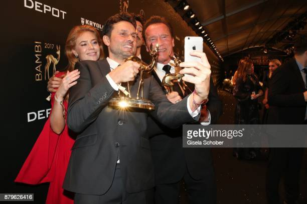 Palina Rojinski Simon Verhoeven and Arnold Schwarzenegger with award take a selfie during the Bambi Awards 2017 winners board at Stage Theater on...