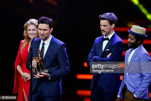 Palina Rojisnki Simon Verhoeven Florian David Fitz and Eric Kabongo pose with award at the Bambi Awards 2017 winners board at Stage Theater on...