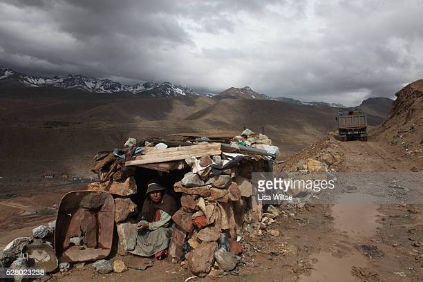 Paliri woman takes a break from sorting through rocks for any traces of silver or tin and relaxes in her hut on Cerro Rico in Potosi Bolivia on...