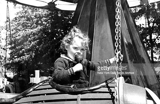 Palisades Amusement Park in Fort Lee NJ Fortified with an apple on a stick this aviatrix is set to take off in a kiddieland airplane