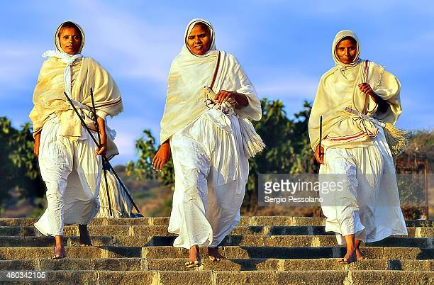 CONTENT] Palitana State of Gujarat India Three jainist nuns descending the 3800 odd stone steps of Shatrunjaya hill leading to the main temple on top...