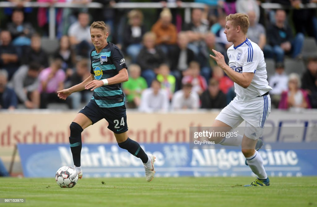 Palko Dardai of Hertha BSC and Dominik Horstmann of MSV Neuruppin during the game between MSV Neuruppin against Hertha BSC at the Volkspar-Stadion on july 12, 2018 in Neuruppin, Germany.